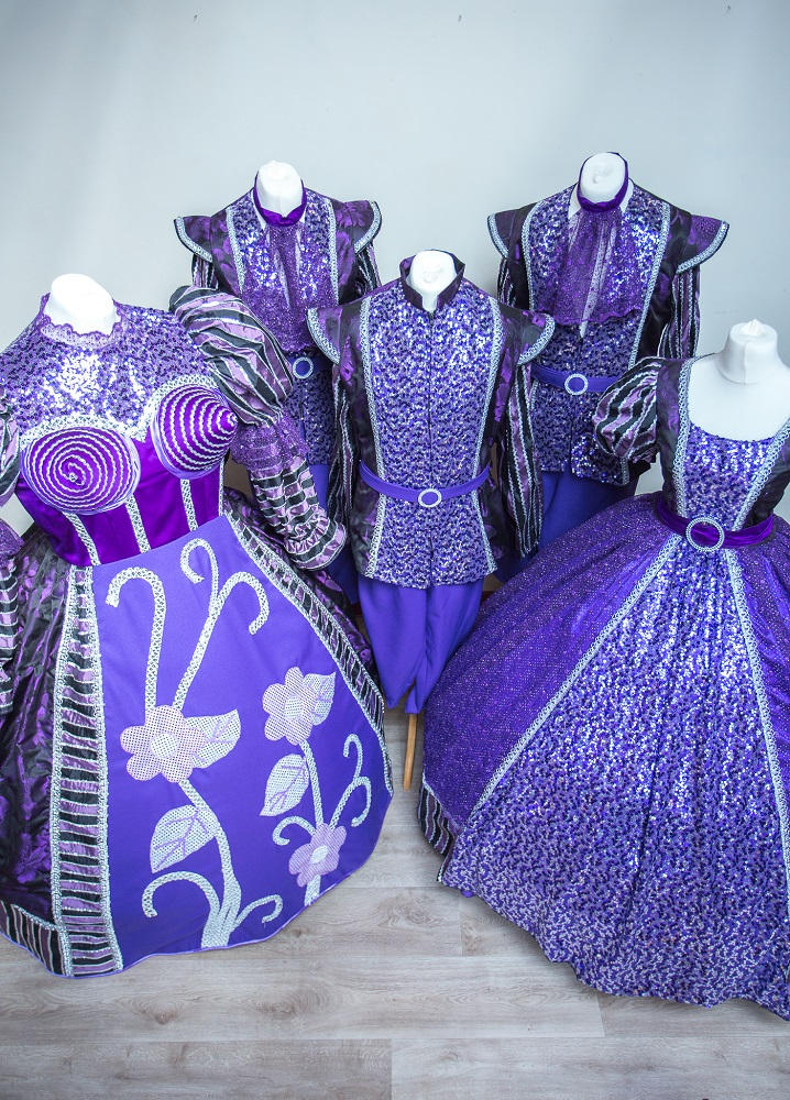 purple finale and ensemble costumes
