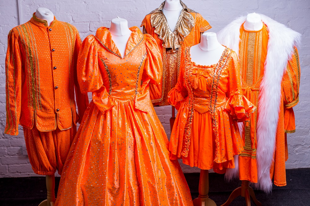 orange panto theme costume hire
